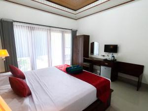 A bed or beds in a room at Chillhouse Lembongan
