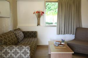 A seating area at Eilot Kibbutz Country Lodging