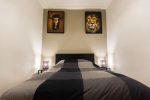 A bed or beds in a room at Spacieux logement au cœur de Marseille centre