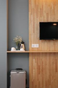 A television and/or entertainment center at 3-Plus Hotel