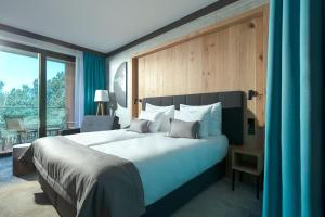 A bed or beds in a room at Gwiazda Morza Resort SPA&SPORT