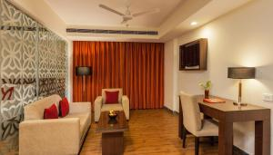 A seating area at Red Fox Hotel, Alwar