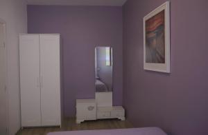 TV a/nebo společenská místnost v ubytování Lillys Cozy Apartment