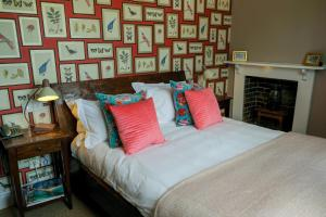 A bed or beds in a room at The Peat Spade Inn