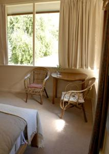 A seating area at Birdwing Bed and Breakfast Weegena