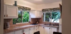 A cozinha ou cozinha compacta de Bungalow Moana