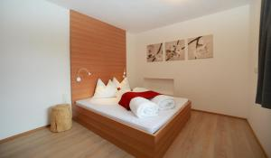 A bed or beds in a room at Villa Rienzner