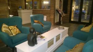 De lobby of receptie bij Hotel La Cascada