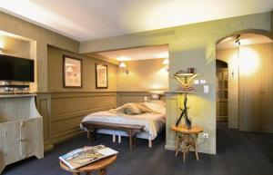 A bed or beds in a room at Residentie De Laurier