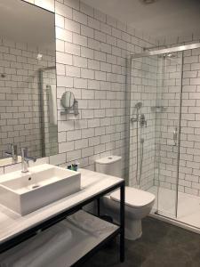 Een badkamer bij Gran Hotel Flamingo-Adults Only