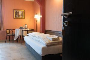 Łóżko lub łóżka w pokoju w obiekcie Willa Koba