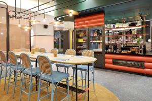 The lounge or bar area at ibis Styles Jakarta Tanah Abang