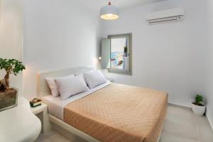 Un ou plusieurs lits dans un hébergement de l'établissement Olive Tree Suites