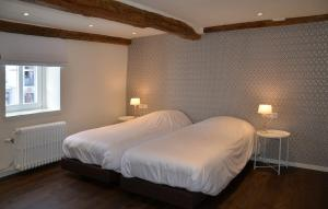 Un ou plusieurs lits dans un hébergement de l'établissement La Maurianne
