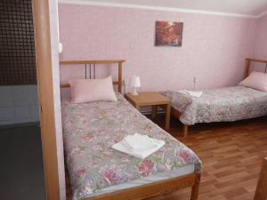 """Кровать или кровати в номере Гостевой дом """"Маныч-Гудило"""""""
