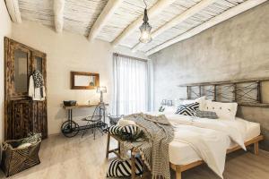 A bed or beds in a room at B&B I Cinque Mori