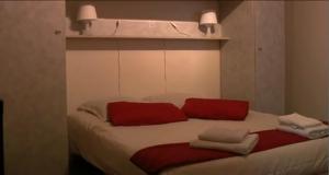 Un ou plusieurs lits dans un hébergement de l'établissement Hotel Anvers