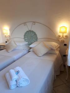 Letto o letti in una camera di Hotel Sorgente