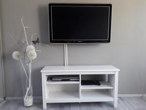 A television and/or entertainment center at Luxury Living Apartment