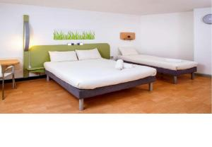 A bed or beds in a room at ibis budget London Hounslow