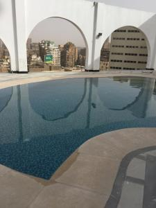 The swimming pool at or near Om Kolthoom Hotel