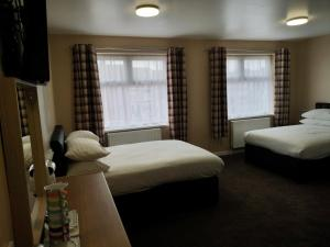 A bed or beds in a room at The Lawton