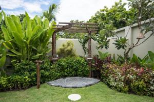 A garden outside Pondok Santi Estate