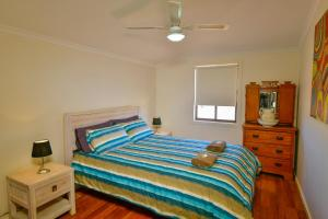 A bed or beds in a room at William Creek Camp Ground & Units
