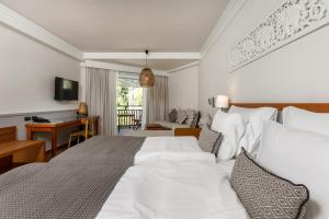 A bed or beds in a room at Sunwing Bangtao Beach - SHA Plus