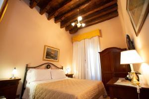 Een bed of bedden in een kamer bij Hotel Giubileo