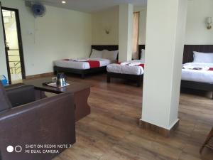 A bed or beds in a room at Hotel Fewa Dream