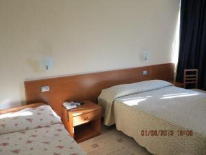 A bed or beds in a room at Albergo Little Garden