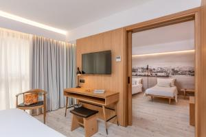 A television and/or entertainment centre at Ibis Styles Heraklion Central