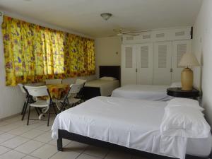 Cama o camas de una habitación en Cozy Apartment in Down Town