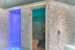 Ein Badezimmer in der Unterkunft Parc Hotel Gritti