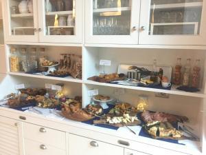 Кухня или мини-кухня в Arli Hotel Hideaway Punta Ala - Adults Only