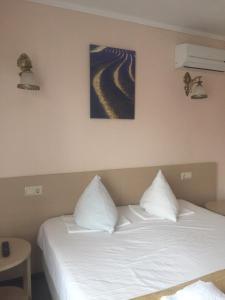 Кровать или кровати в номере Гостевой Дом Амалия