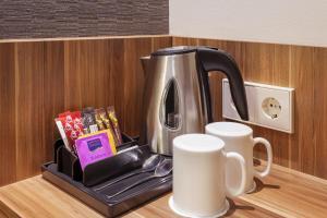 Coffee and tea-making facilities at Holiday Inn Express Augsburg, an IHG Hotel