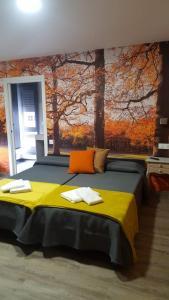 Cama o camas de una habitación en Pensión San Marcos