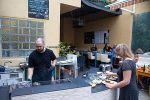 A restaurant or other place to eat at Station - Hostel for Backpackers