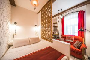 Cama ou camas em um quarto em Revelton Studios Baku