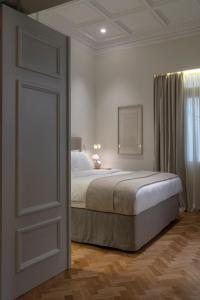 A bed or beds in a room at COCO-MAT Athens Jumelle
