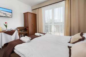 Łóżko lub łóżka w pokoju w obiekcie B&B Maszoperii 15