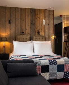 A bed or beds in a room at Max Brown Hotel Canal District