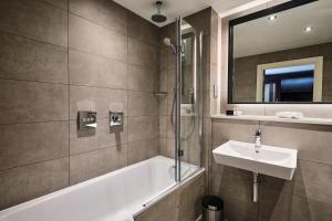 A bathroom at Llanerch Vineyard Hotel