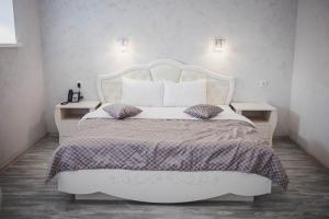 Кровать или кровати в номере Диамант Домодедово