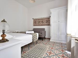 A bed or beds in a room at Villa Janas