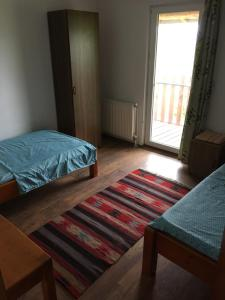 A bed or beds in a room at Twins V.V.T Hostel
