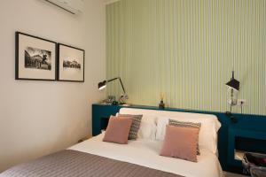 Letto o letti in una camera di Santa Chiara Boutique Hotel