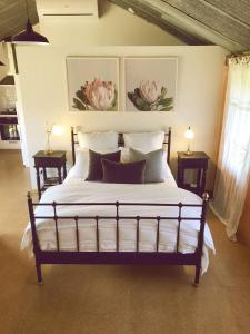 A bed or beds in a room at La Casetta (The Little House)